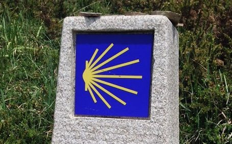The scallop shell symbol, commonly seen on trail markings.
